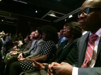 Audience members watching the debate